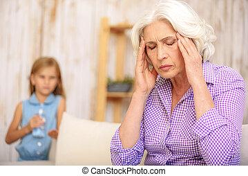 Mature grandmother feels terrible pain