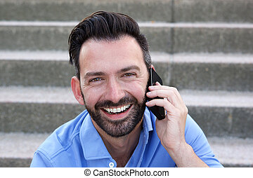 Mature guy talking on mobile phone and smiling