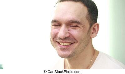 mature handsome man laughing portrait studio