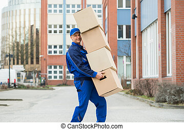 Delivery Man Carrying Cardboard Box