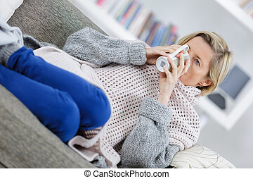 mature illness woman drinking hot tea at home