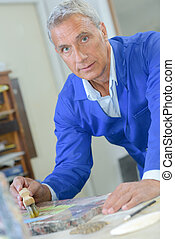 Mature male artist at work