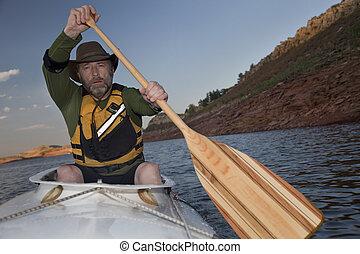 mature male in a canoe