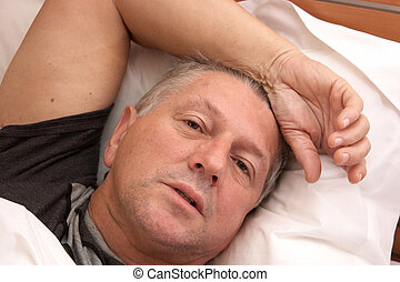 Mature male in bed