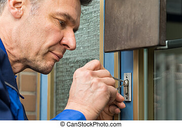 Male Lockpicker Fixing Door Handle At Home - Mature Male ...