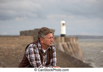 Mature Male looking out to sea