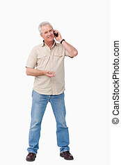 Mature male on his cellphone