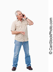 Mature male talking on his cellphone