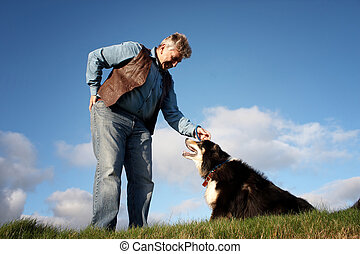 Mature man and a sheep dog - Sheep dog looking into the eyes...