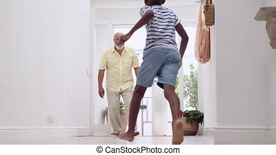Mature man and his grandson - Front view of a mature mixed ...