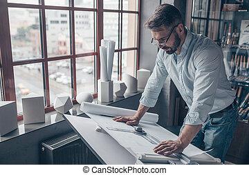 Mature man at work in the studio