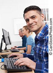 Mature Man Attending Computer Class