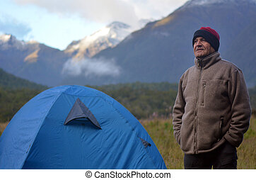Mature man camping