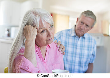 Mature Man Comforting Woman With Depression At Home
