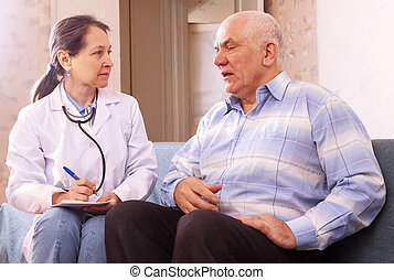 mature man complaining to doctor about feels