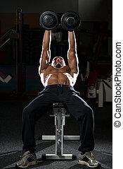 Mature Man Doing Dumbbell Incline Bench Press Workout -...