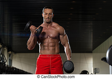 Mature Man Doing Exercise For Biceps