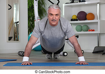 Mature man doing pushups