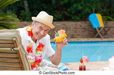 Mature man drinking a cocktail  bes