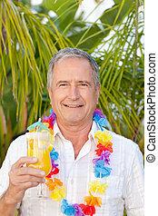 Mature man drinking a cocktail unde
