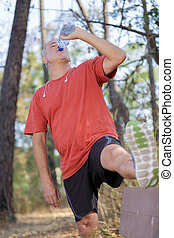 mature man drinking water from a bottle