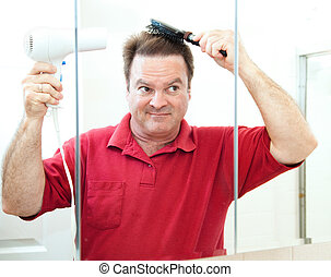 Mature Man Drying His Hair