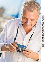 Mature Man Holding Camera