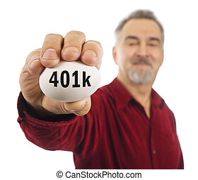 Mature man holds an egg with 401k on it.