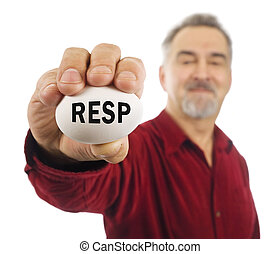 Mature man holds an egg with RESP on it.