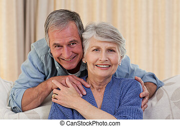 Mature man hugging his wife