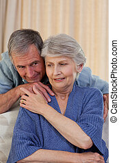 Mature man hugging his wife