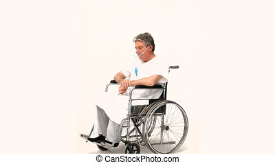 Mature man in a wheelchair isolated on a white background