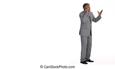 Mature man in suit making a phone call
