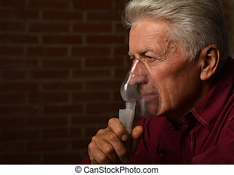 Mature man  inhalator
