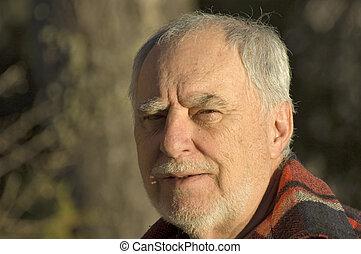 Mature man laughing - Outdoor portrait of a senior man...
