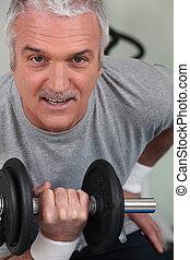 mature man lifting weight
