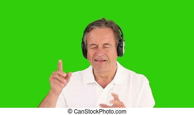 Mature man listenning to music