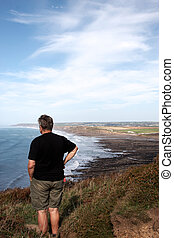 Mature man looking out to sea