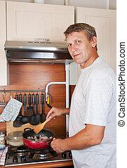 mature man makes supper