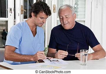 Mature Man playing Sudoku Puzzle - Portrait of mature man...