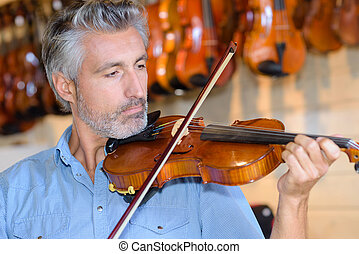 Mature man playing violin