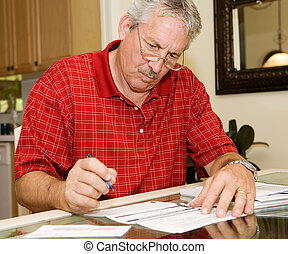 Mature Man Signing Papers - Handsome mature man signing...
