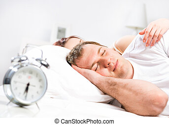 man sleeping in bed - Mature man sleeping in bed with his...