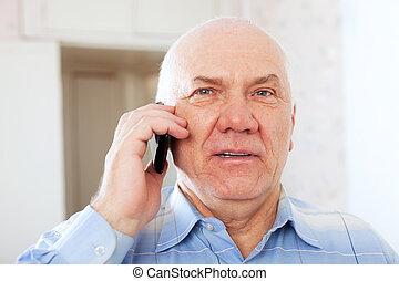 mature man speaks by phone - Portrait of calm mature man...
