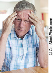 Mature Man Suffering From Memory Loss