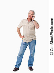 Mature man talking on his cellphone