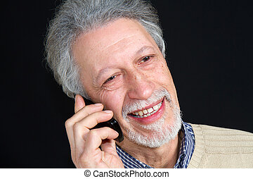 mature man talking on his mobile phone