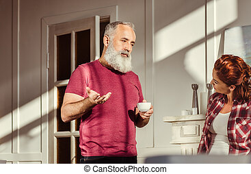 Mature man talking with woman