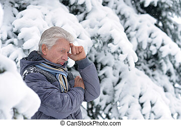 mature man thinking about something
