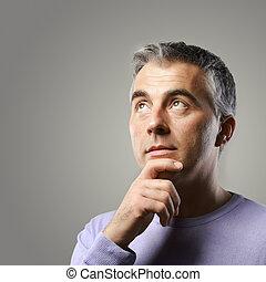 Mature man thinking